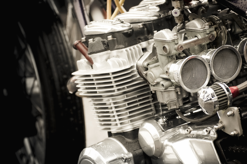 image of a carburettor on a motorbike engine - click for link to a blog entry on carburettor cleaning cleaning
