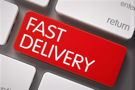 "image showing a computer keyboard with a key with the wording ""fast delivery"""